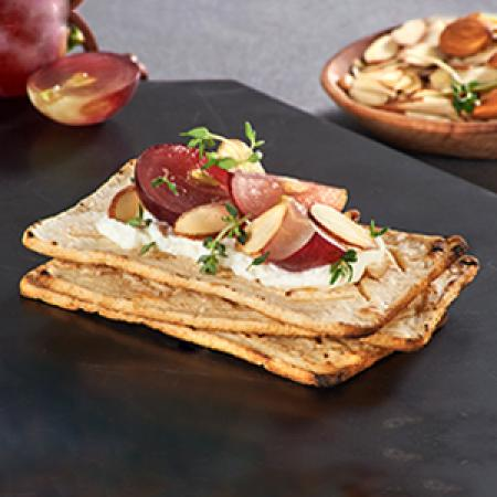Salmas with Sour Cream, Grapes and Almonds